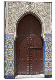 Lienzo  Wooden door in decorated archway - Nico Tondini