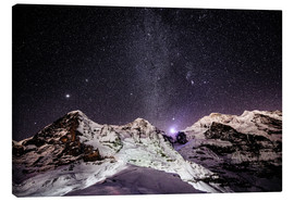 Lienzo  Eiger, Monch and Jungfrau mountain peaks at night - Peter Wey