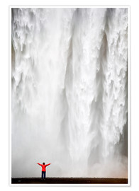 Póster  Woman in red jacket standing in front of Skogafoss waterfall, South Iceland, Iceland, Polar Regions - Lee Frost