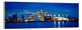 Cuadro de madera  Panoramic view of London skyline over the River Thames featuring Canary Wharf, O2 Arena and The Shar - Ian Egner