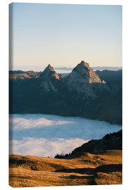 Lienzo  Grosser and Kleiner Mythen mountain peak above cloudscape at sunrise - Peter Wey