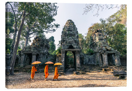 Lienzo  Monks with umbrellas inside Angkor Wat temples, Cambodia - Matteo Colombo