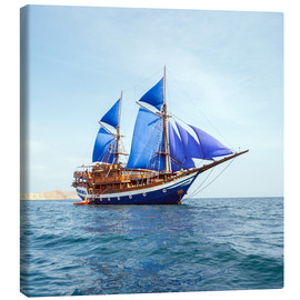 Lienzo  Vintage Wooden Ship with Blue Sails