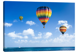 Lienzo  Colorful hot air balloons on the blue sea