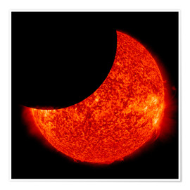 Póster  A partial solar eclipse from space.