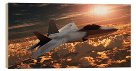 Cuadro de madera  An F-22 fighter jet flies at an altitude above the cloud layer on its mission. - Corey Ford