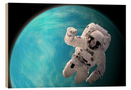 Cuadro de madera  Artist's concept of an astronaut floating in outer space by a water covered planet. - Marc Ward