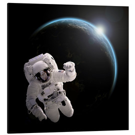 Cuadro de aluminio  Astronaut floating in space as the sun rises on to Earth-like planet. - Marc Ward