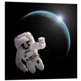 Cuadro de PVC  Astronaut floating in space as the sun rises on to Earth-like planet. - Marc Ward