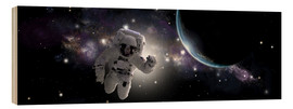 Cuadro de madera  Astronaut floating in outer space - Marc Ward