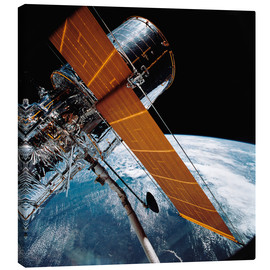 Lienzo  The Hubble Space Telescope backdropped by planet Earth.