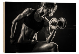 Madera  Sportswoman with dumbbells