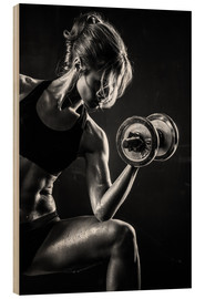 Madera  Sportswoman with dumbbell