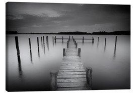 Lienzo  Old wooden pier in the still waters - Filtergrafia