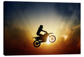 Lienzo  Biker jumping at sunset