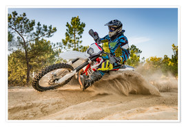 Enduro biker on sand terrain