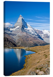 Lienzo  Hikers walking on the path beside the Stellisee with the Matterhorn reflected. Zermatt Canton of Val - Roberto Sysa Moiola