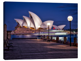 Lienzo  A boat passes by the Sydney Opera House, UNESCO World Heritage Site, during blue hour, Sydney, New S - Jim Nix