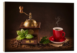 Madera  Coffee mill with beans and green leaves and a cup of coffee - Elena Schweitzer