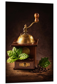 Forex  Coffee mill with beans and green leaves and a cup of coffee - Elena Schweitzer