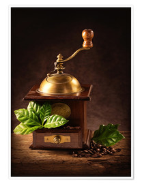 Póster Coffee mill with beans and green leaves and a cup of coffee