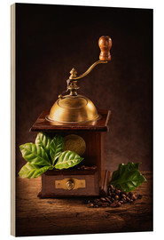 Cuadro de madera  Coffee mill with beans and green leaves and a cup of coffee - Elena Schweitzer