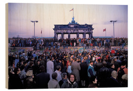 Berliners from East and West celebrating the opening of the border at the Berlin Wall