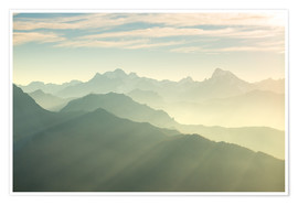 Póster Sunlight behind mountain peaks silhouette, the Alps.