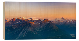 Cuadro de madera  Sunset over rocky mountain peaks, ridges and valleys, the Alps. - Fabio Lamanna