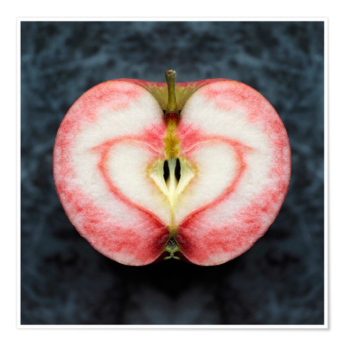 Póster Overhead view of near symmetrical apple half with red heart shape stain