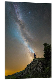 Cuadro de PVC  Man shining a flashlight on the Milky Way from atop a mountain in Russia. - Yuri Zvezdny