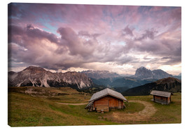 Lienzo  Pink clouds at sunset on the typical huts of Odle mountain range seen from Seceda, Val Gardena, Tren - Roberto Moiola