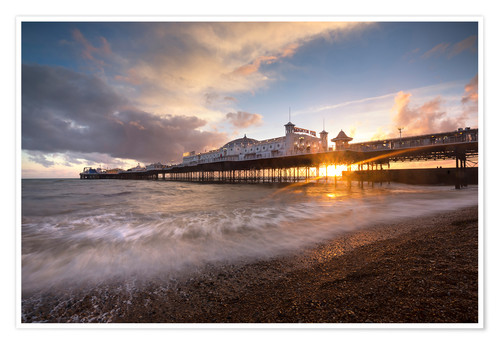 Póster Brighton pier at sunset with dramatic sky